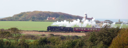 The North Norfolk Railway travelling through Weybourne